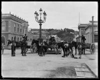 Nelson City Council, workers and carts.  View of a street cleaning gang on the c